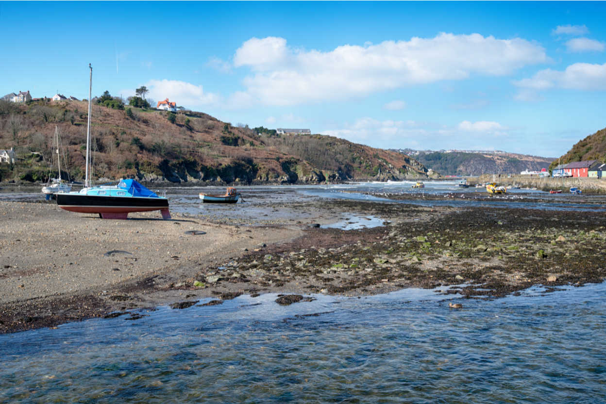 Fishing boats on the River Gwaun at Lower Town in Fishguard on the Pembrokeshire coast in Wales